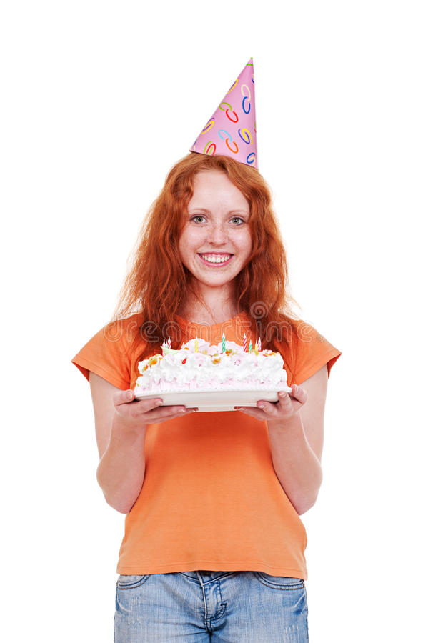 Fille souriante en gâteau drôle de fixation de capuchon photo libre de droits