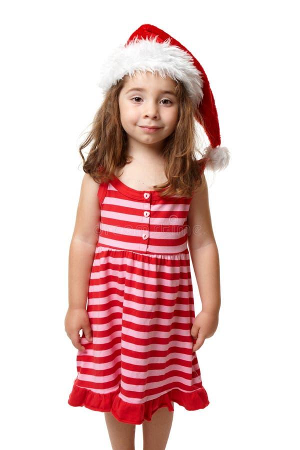 Fille utilisant un chapeau de Santa au temps de Noël photo libre de droits
