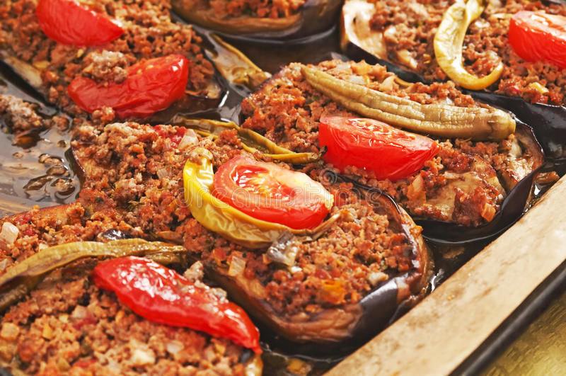 Filled aubergine. With hash and tomato stock photography