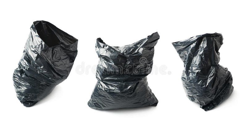 Filled black plastic garbage bag isolated. Over the white background, set collection of three different foreshortenings royalty free stock images