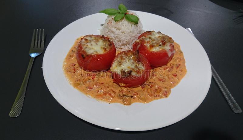 Filled tomatoes with rice stock photos
