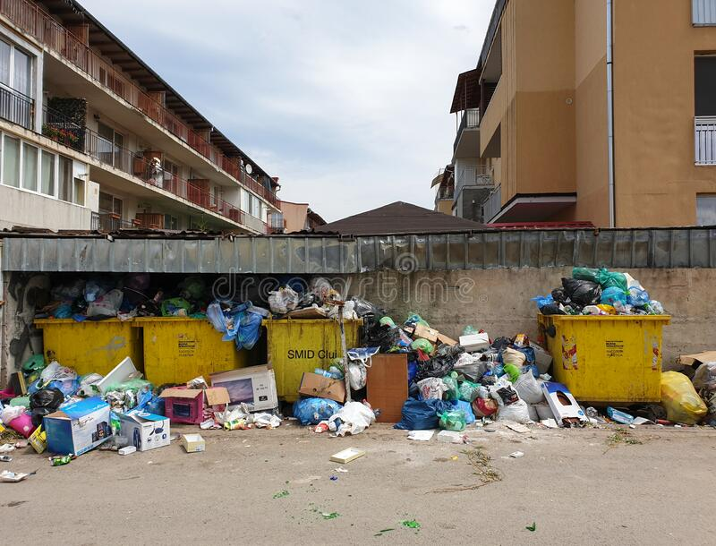 Filled trash bins in populated area in Floresti stock photography
