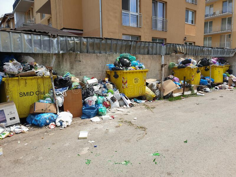 Filled trash cans in populated area in Floresti stock photography