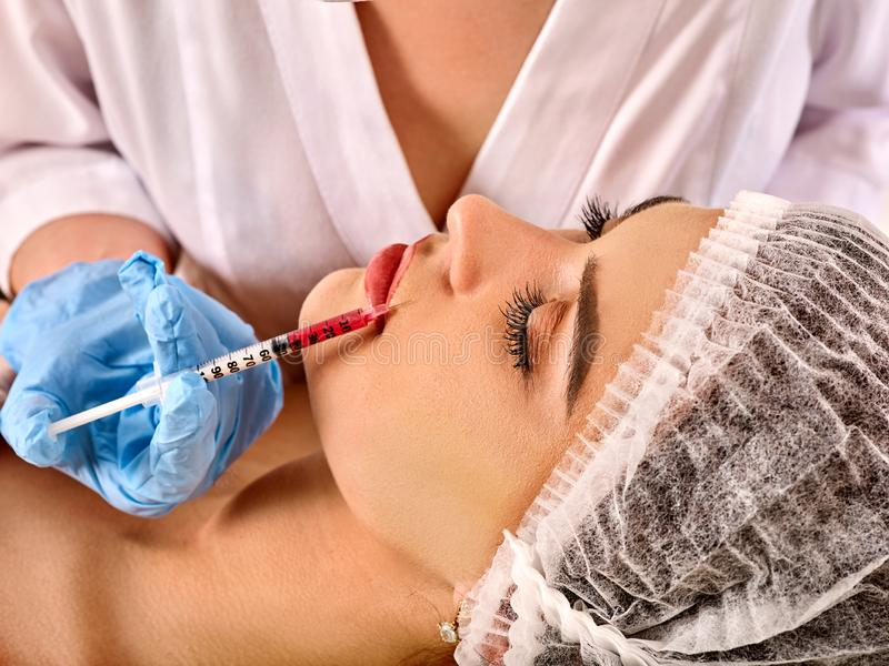 Dermal fillers of woman in spa salon with beautician. Filler injection for female face. Plastic aesthetic facial surgery in beauty clinic. Medical cosmetologist stock photography