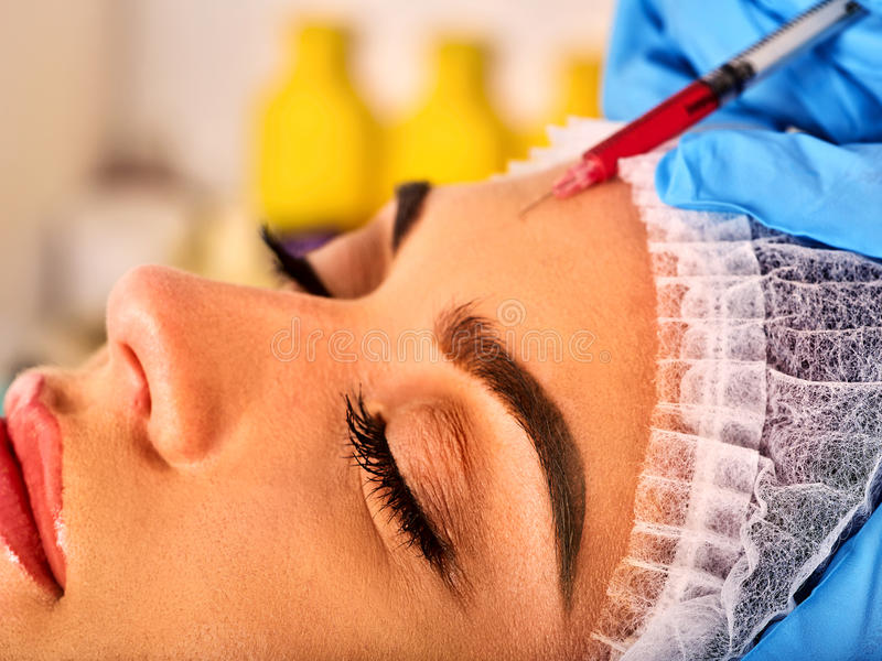 Filler injection for forehead face. Plastic aesthetic facial surgery . Filler injection for female forehead face. Plastic aesthetic facial surgery in beauty royalty free stock photos