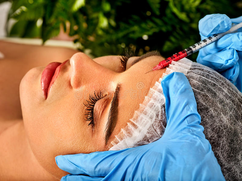Filler injection for forehead face. Plastic aesthetic facial surgery. Filler injection for female forehead face. Plastic aesthetic facial surgery in beauty royalty free stock images