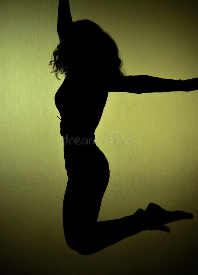 Filles de silhouette en vol photographie stock