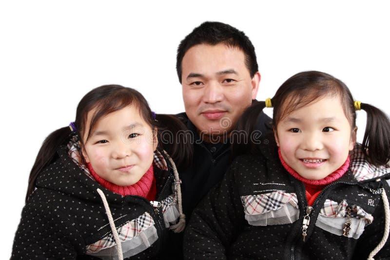 Filles et père de jumeaux images libres de droits