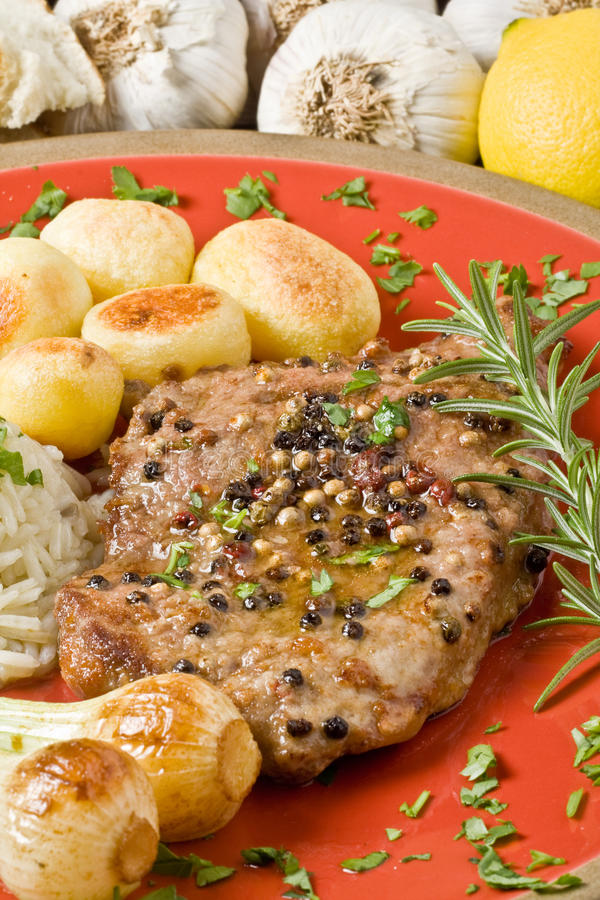 Fillet Mignon. With pepper and garlic royalty free stock photos