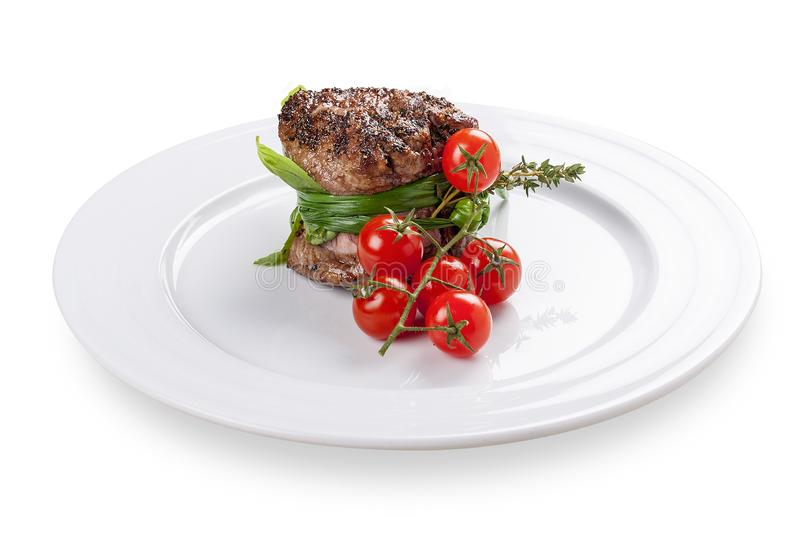 Fillet mignon with cherry tomatoes. stock photography