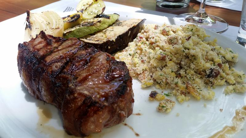Fillet mignon with crumbs. And vegetable royalty free stock images