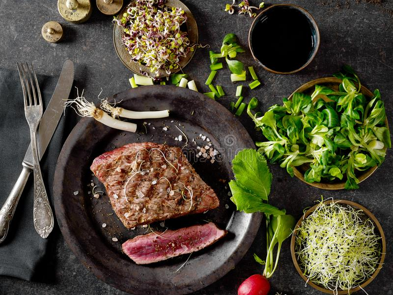 Fillet mignon and greens. From above royalty free stock images