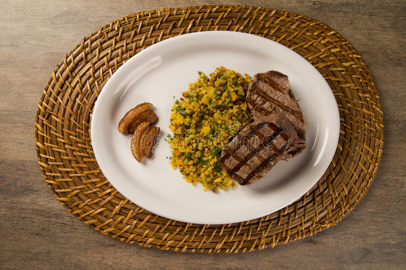 Fillet mignon grilled on plate with crumbs and bacon stock images