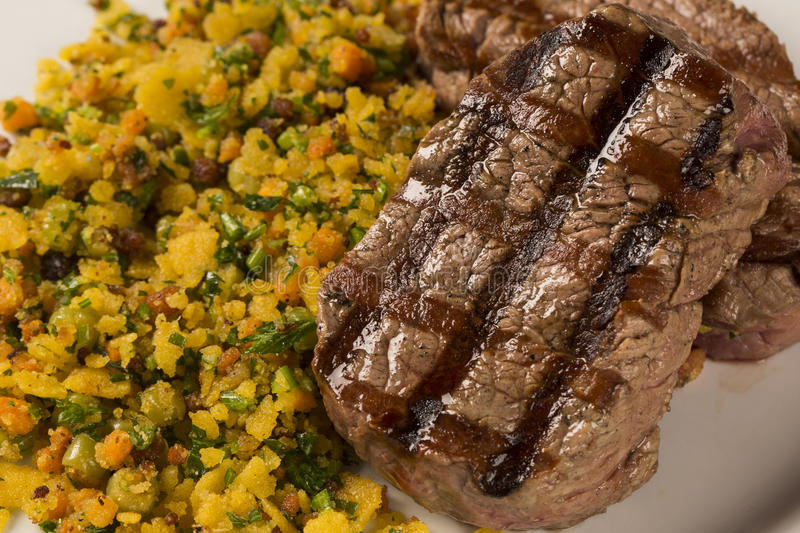 Fillet mignon grilled on plate with crumbs and bacon stock photos