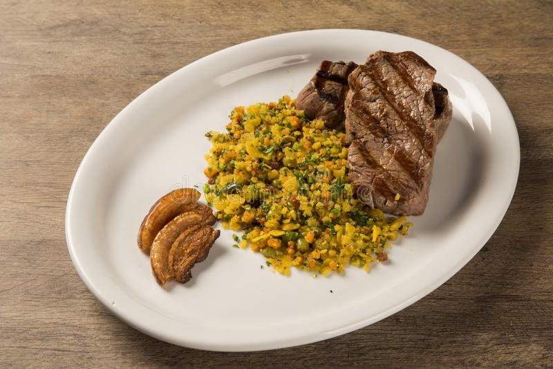 Fillet mignon grilled on plate with crumbs and bacon royalty free stock photo