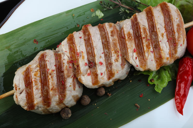 Fillet mignon. Grilled pork Fillet mignon with herbs and spices royalty free stock images