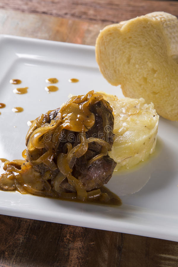 Fillet Mignon with sauté potatoes / Steak Beef with passion fruit sauce stock photo