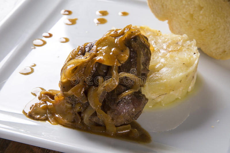 Fillet Mignon with sauté potatoes / Steak Beef with passion fruit sauce.  royalty free stock photography