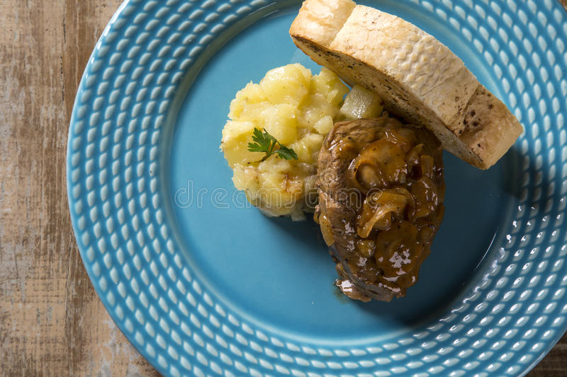 Fillet Mignon with sauté potatoes / Steak Beef with passion fruit sauce.  royalty free stock photo