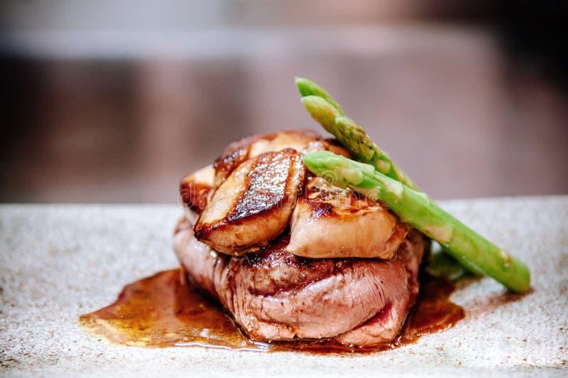 Fillet mignon steak with Foie Gras Teppanyaki dining style royalty free stock photo