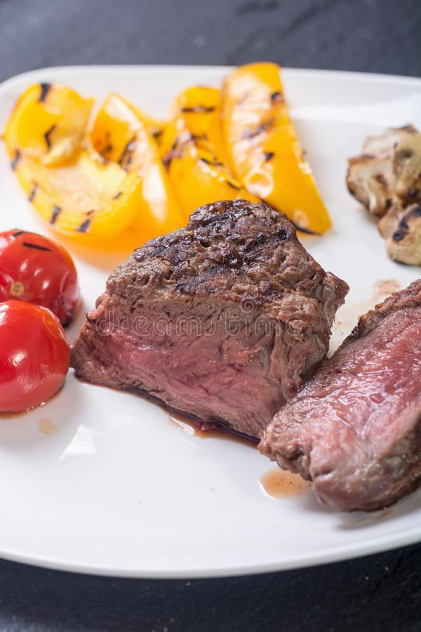 Fillet mignon steak. With grilled vegetables tomatoes , pepper , mushrooms royalty free stock photography