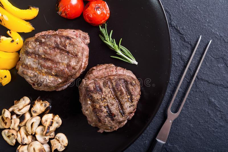 Fillet mignon steak. With grilled vegetables tomatoes , pepper , mushrooms stock photos