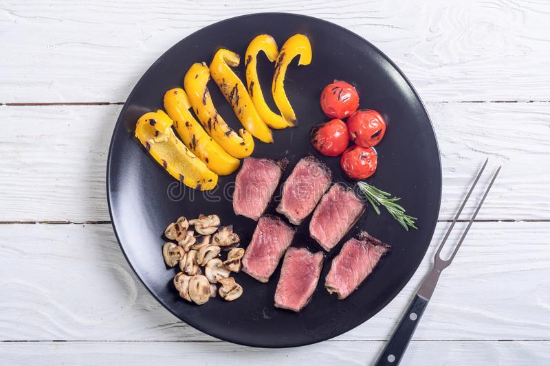 Fillet mignon steak. With grilled vegetables tomatoes , pepper , mushrooms royalty free stock photos