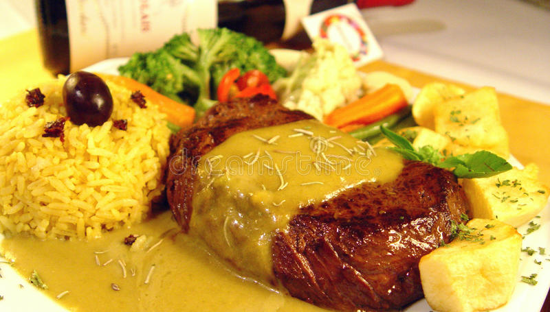 Fillet Mignon steak with mustard sauce royalty free stock photo