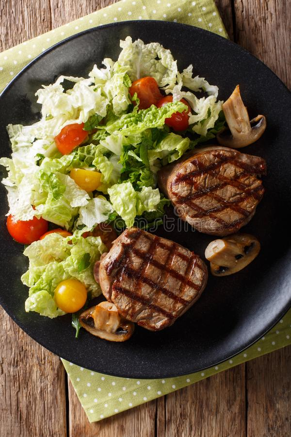 Fillet mignon steak with a salad of napa cabbage and tomatoes cl royalty free stock photo