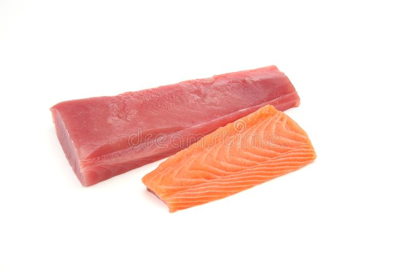 Fillet of raw salmon and tuna in a white background. Pictured fillet of raw salmon and tuna in a white background royalty free stock image