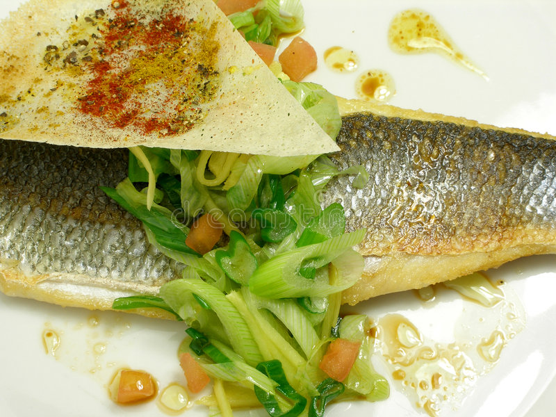 Fillet of sea bass with spring onions and soy sauce royalty free stock photo