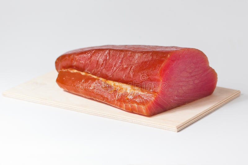 Fillet of Tuna Fish. On a wooden board royalty free stock image