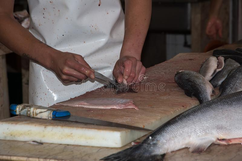 Filleting Fish. In the fish market in funchal Madeira stock photography
