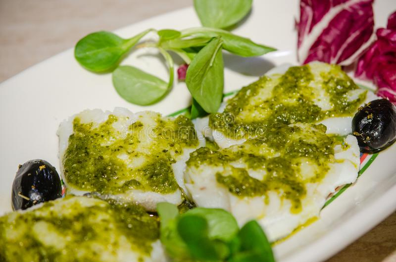 Fillets of seasoned cod royalty free stock photography