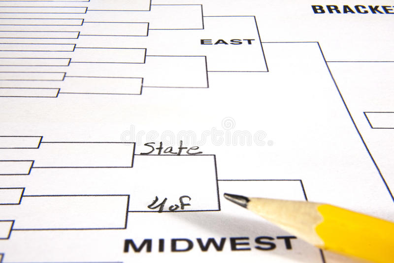 Filling in the Bracket. Sixty four team playoff bracket with two lines fille in and a pencil royalty free stock photography