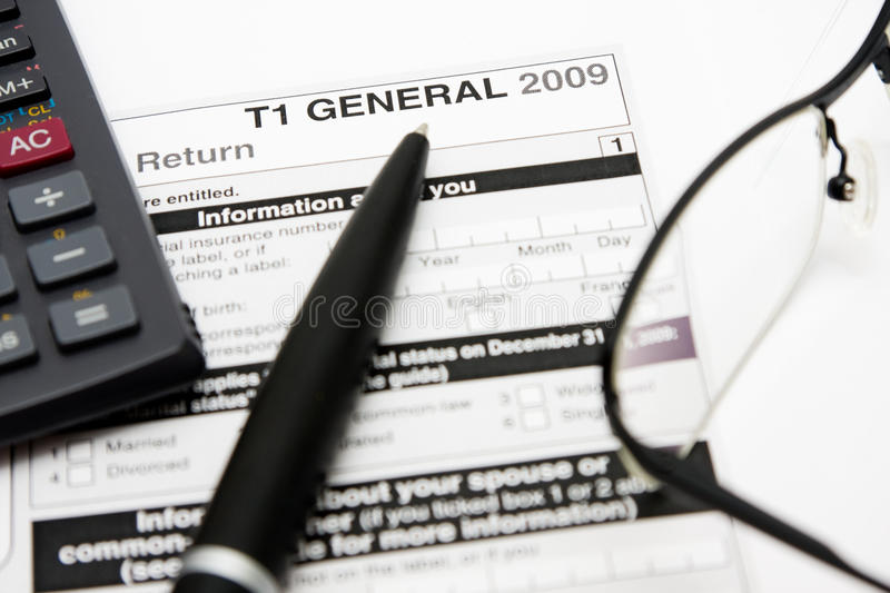 Filling in canadian tax form. Filling in canadian individual tax form T1 for year 2009 royalty free stock photo