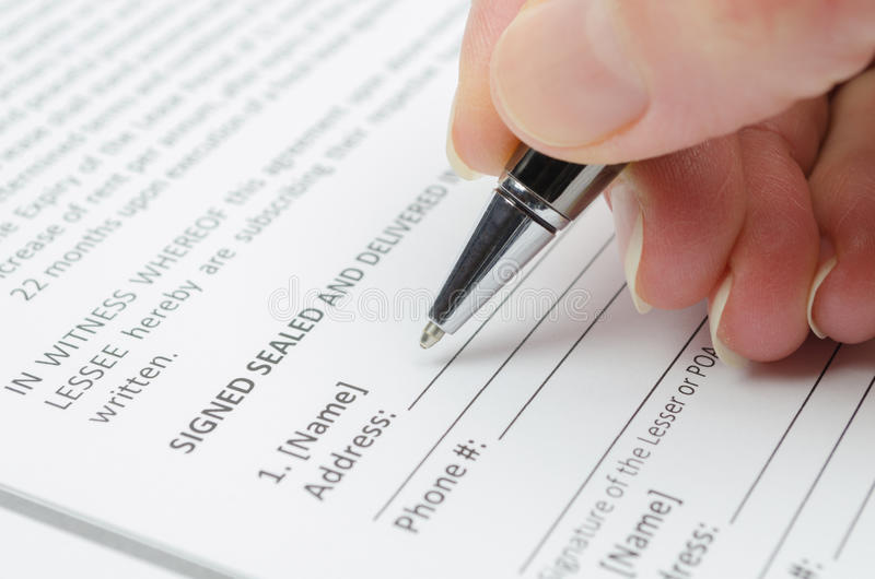 Filling document. Female hand filling document close up royalty free stock photo