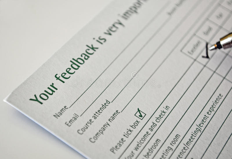 Filling feedback form. A feedback form closeup for hotel and a ball pen royalty free stock images