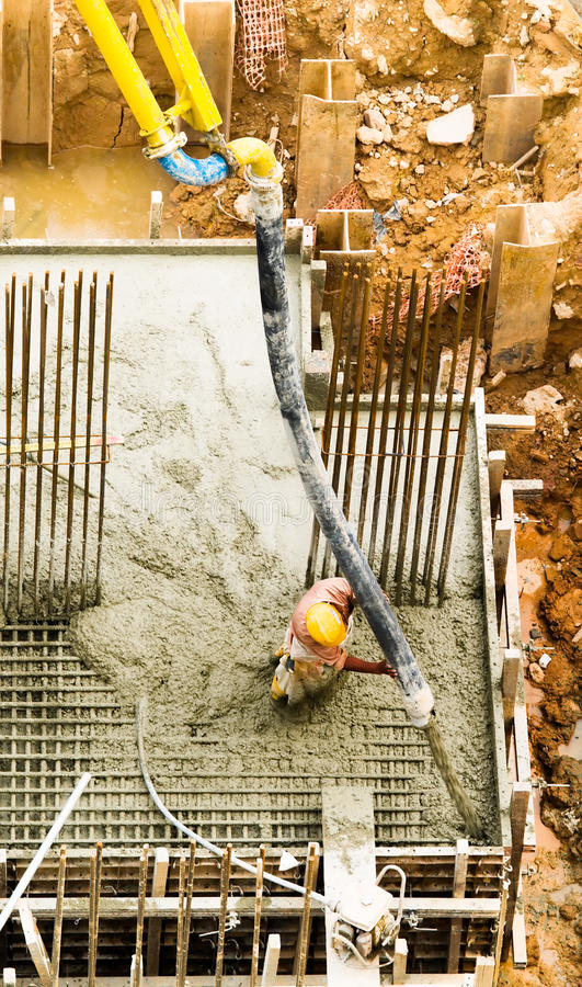 Filling a Foundation with Concrete stock photos