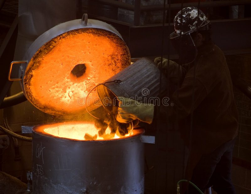Filling the Furnace stock images