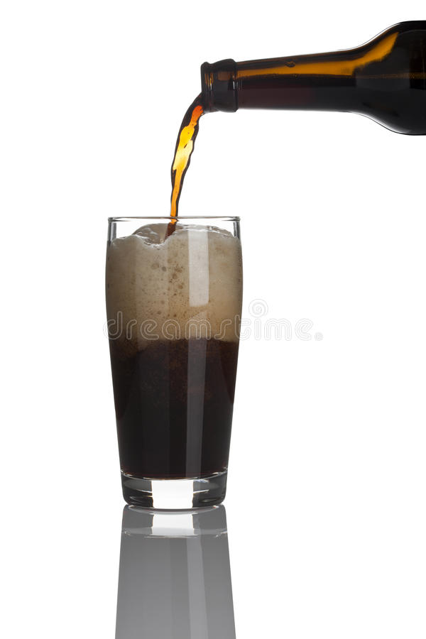 Filling a glass of stout beer royalty free stock photos