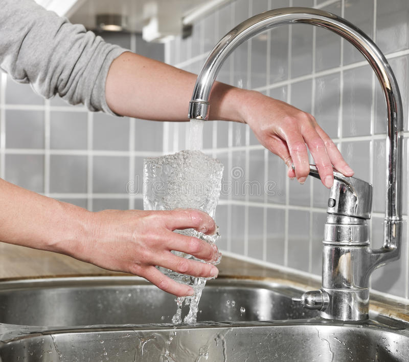 Download Filling a glass of water stock photo. Image of hand, splashing - 14762880