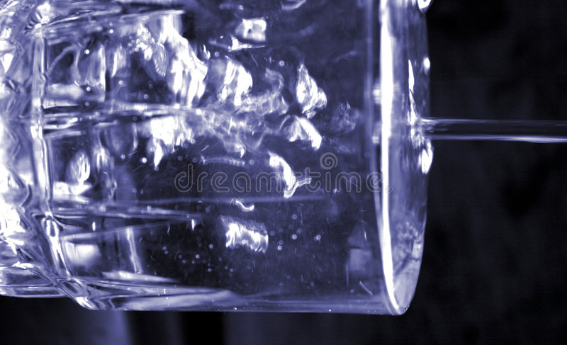 Filling A Glass Of Water Royalty Free Stock Photography