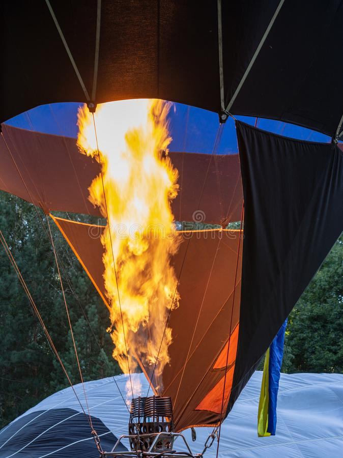Filling hot air balloon. flame with burner stock image