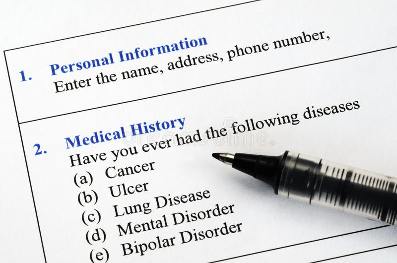 Filling the patient medical history questionnaire royalty free stock photo