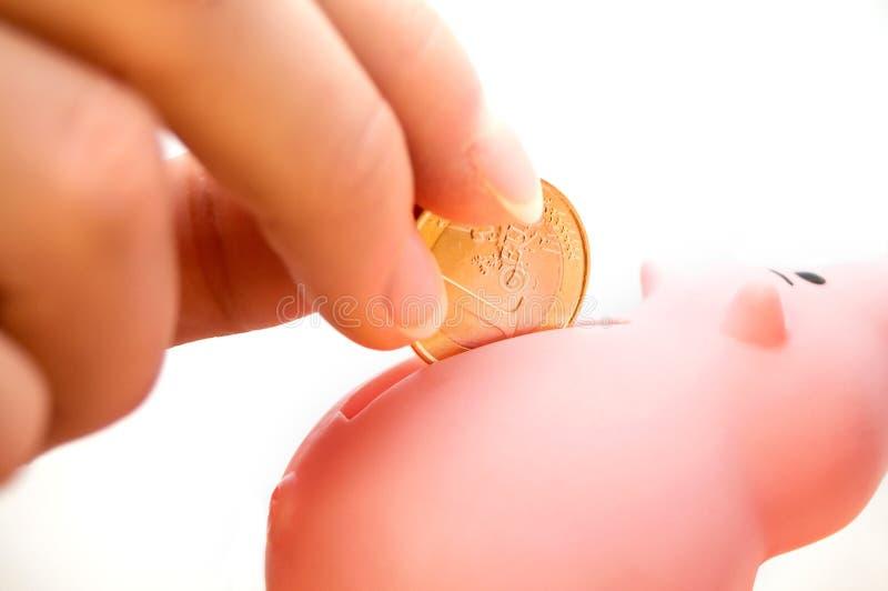 Filling A Piggybank Stock Images