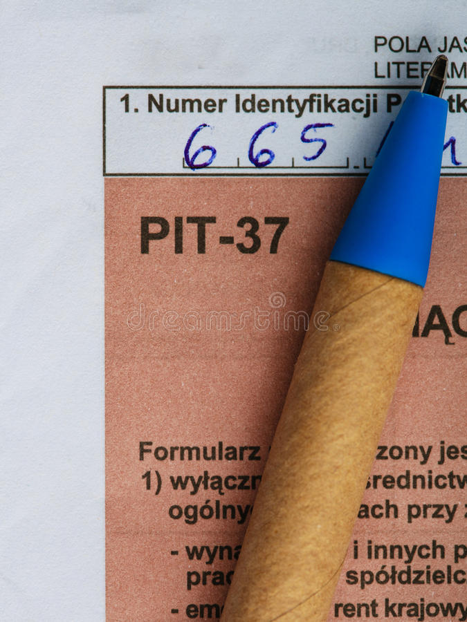 Filling in polish individual tax form PIT-37 for year 2013. Filling in polish individual income tax form PIT-37 for year 2013 stock photo