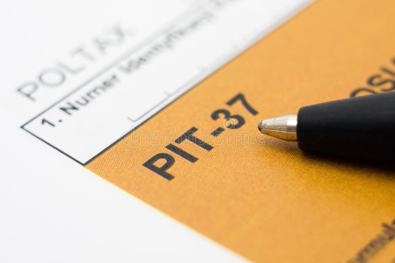 Filling in polish tax form. Filling in polish individual tax form PIT-37 for year 2009 stock photos