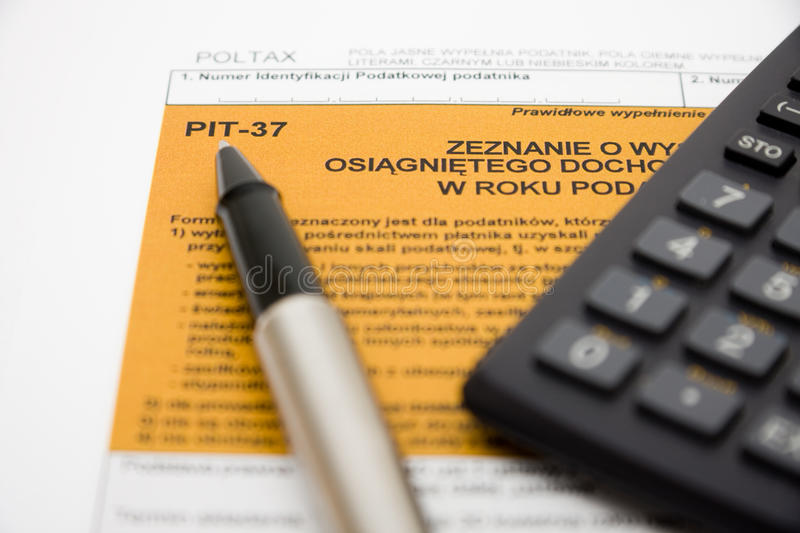 Filling in polish tax form. Filling in polish individual tax form PIT-37 for year 2009 stock image