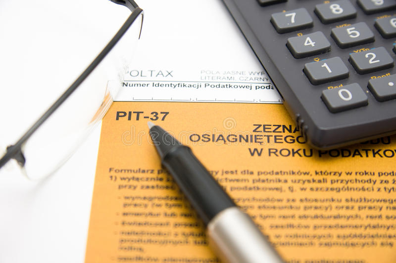 Filling in polish tax form. Filling in polish individual tax form PIT-37 for year 2010 royalty free stock photos